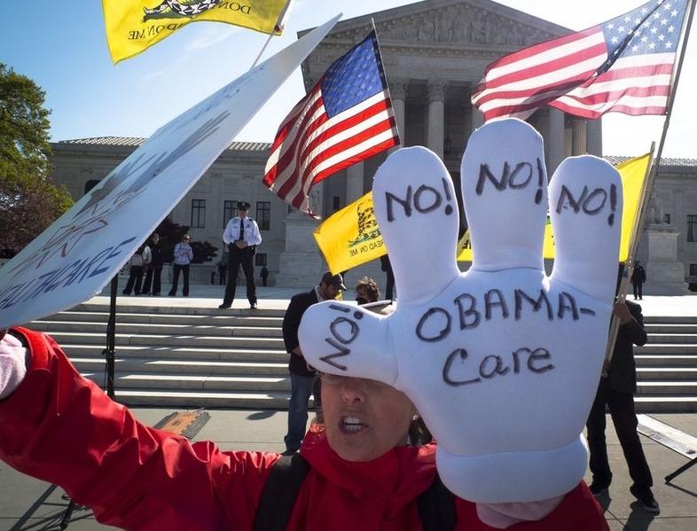 特朗普2月23日表示,需要在完成奧巴馬健保的改革之後,才會推出稅務改革。(Mladen Antonov/Getty Images)