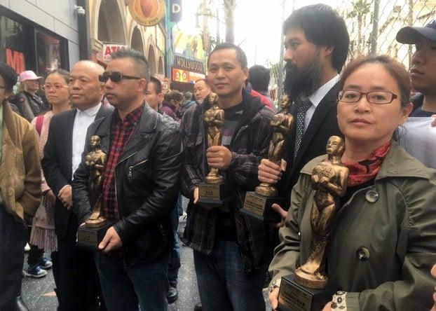 江天勇妻子金變玲(右一)代表「709」家屬領獎,其餘為另外三組獲獎者的領獎代表。(自由亞洲電台)