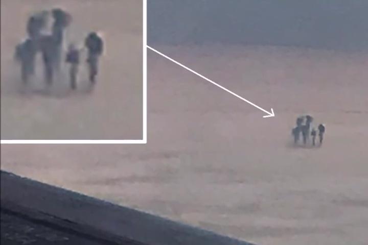 目擊者的照片顯示雲層上的人形物體,似乎不是一個人,而是四個人。(Youtube視像擷圖)