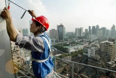 中共推行城鎮化建設已二十餘年,但是在城鎮化的背後是持續嚴重的社會不公。(法新社)