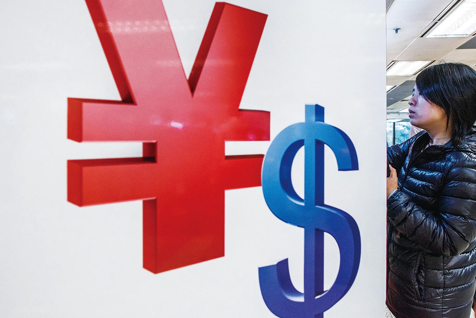 人民幣貶值勢必影響多數中國人的日常生活。(Getty Images)