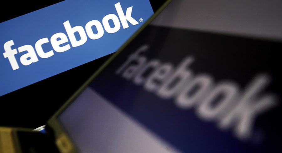 美國匹茲堡大學的研究發現,使用社交媒體的時間越多,社會隔絕感越高。(LEON NEAL/AFP/Getty Images)