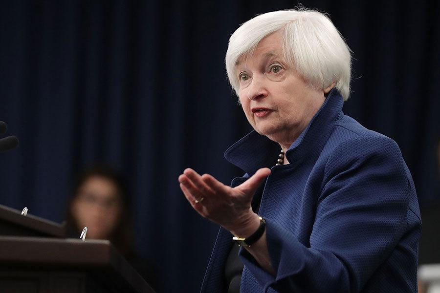 由於美國經濟強勁增長且充滿信心,美聯儲15日決定加息,主席耶倫表示美國民眾現在可以考慮換更好的工作了。(Chip Somodevilla/Getty Images)