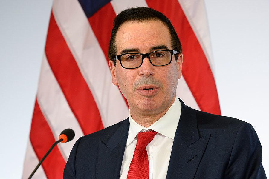 美國財長姆欽(Steven Mnuchin)在G20財長會議上發言。(THOMAS KIENZLE/AFP/Getty Images)