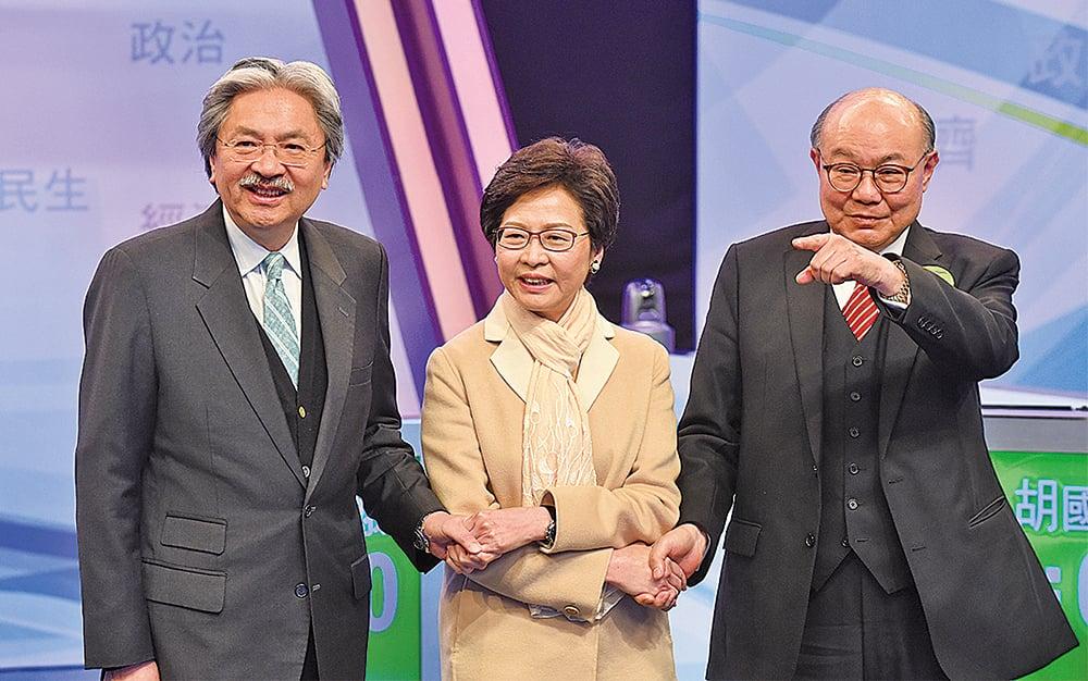 香港特首選舉進入衝刺階段之際,民調顯示,曾俊華(左)民調高出林鄭月娥(中)近20%;同時,林鄭月娥被曝不少醜聞。另一候選人胡國興(右)的支持度則繼續徘徊在不足10%。(大紀元資料圖片)
