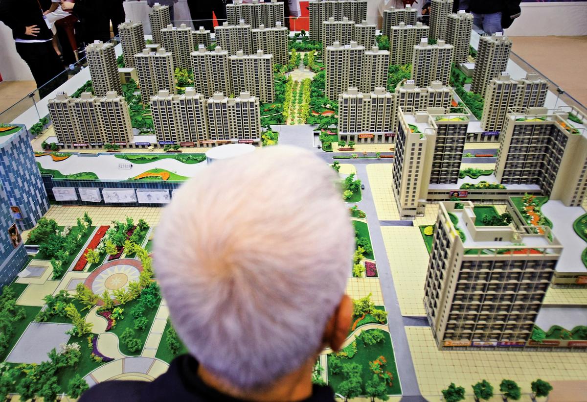 因為限購,一些有住房需求的人為了獲取購房資格,不得已假結婚。為購房假結婚假離婚竟然成為產業鏈。(Getty Images)