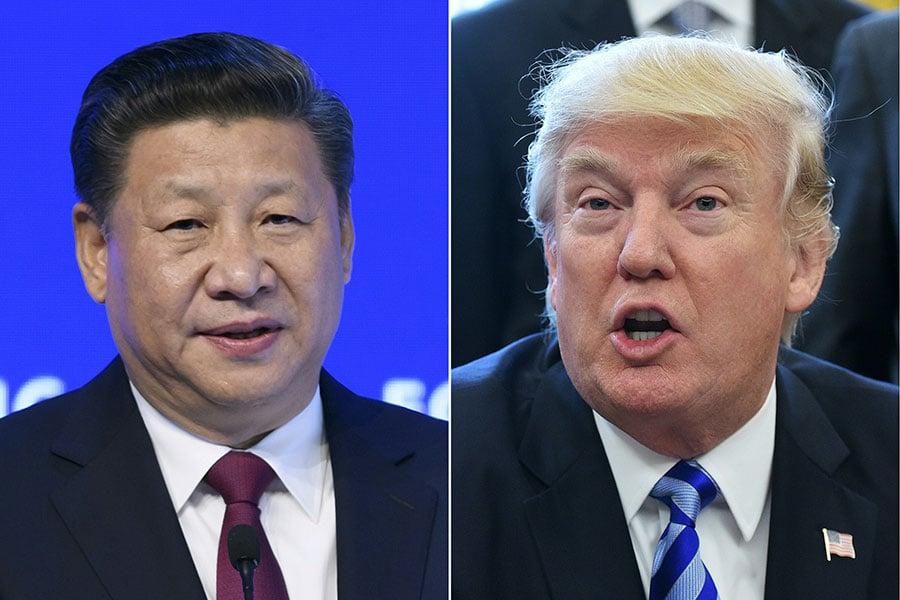 特朗普總統周四(4月6日)早上說,他跟習近平的會晤沒有人知道會發生甚麼。他說,圍繞貿易和北韓最近導彈測試的問題預計將擺上桌面。(FABRICE COFFRINI,MANDEL NGAN/AFP/Getty Images)