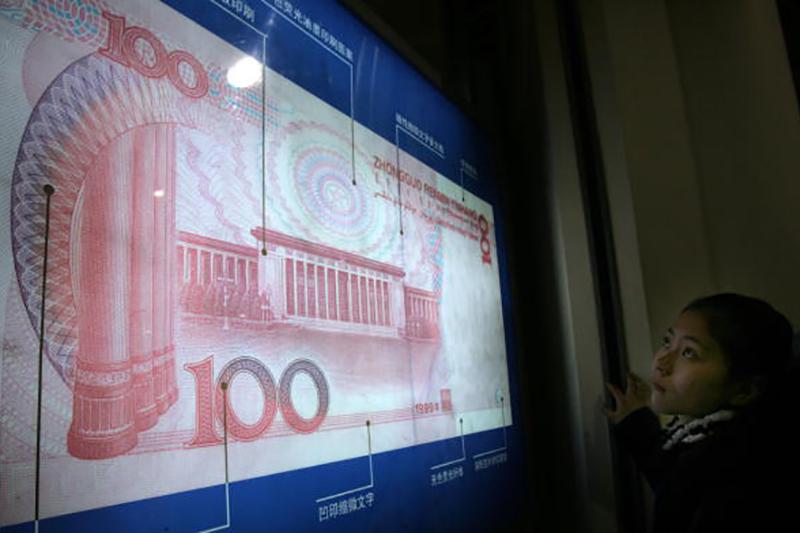 特朗普總統周三(12日)表示,中國不會被定為「貨幣操縱國」。(AFP/Getty Images)