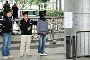 警拘六人涉立會縱火案