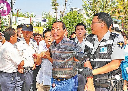 2010年5月18日,韓國水原地方法院安山支院判定曾攻擊法輪功學員的中國籍兇犯崔萬吉(音)以及移民韓國的崔春植(音)有罪。兩人分別被判有期徒刑8個月及4個月,緩刑2年。(大紀元資料圖片)