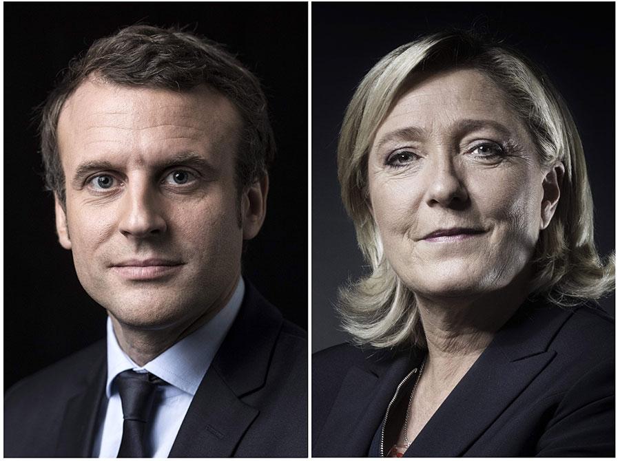 法國大選第一輪,政壇新人和邊緣黨派領袖戰勝了兩大傳統政黨,將在5月7日爭奪總統寶座。(ERIC FEFERBERG, JOEL SAGET/AFP/Getty Images)