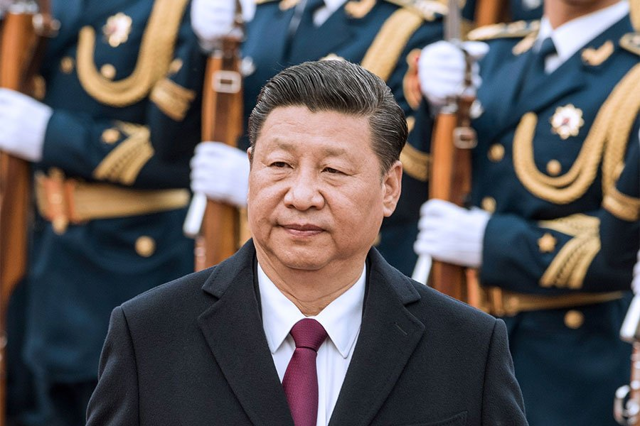 韓媒評論指,北韓領導人金正恩與中國國家主席習近平之間正在進行緊張的心理戰:習近平不承認金正恩是北韓領導人,而金正恩也在努力脫離北京的掌控。(FRED DUFOUR/AFP/Getty Images)