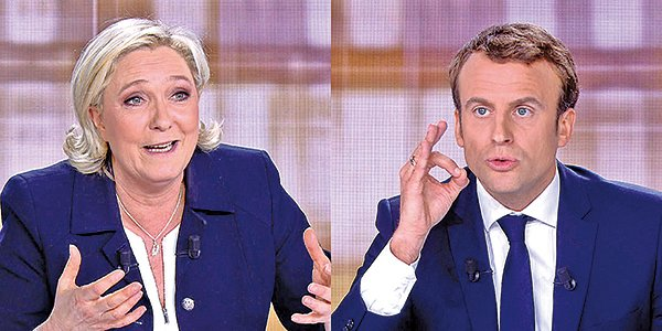 5月3日,法國大選候選人馬克龍(Emmanuel Macron)和瑪麗娜勒龐(Marine Le Pen)舉行電視直播辯論。(AFP)
