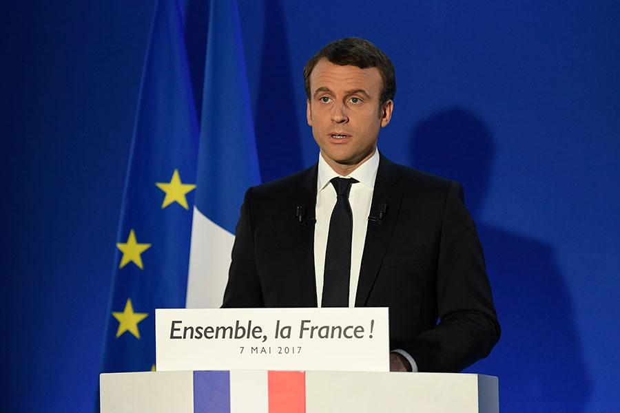 法國總統當選人馬克龍(Emmanuel Macron)的政黨今天推派400多名候選人,參加6月舉行的國會選舉,其中一半是政治素人,一半是女性。(LIONEL BONAVENTURE/AFP/Getty Images)