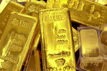 據澳洲媒體近日報道,今年以來,中國投資者一直搶購金條和金幣來避險,令黃金銷量暴增。這與國際國內多重因素有關。(JUNG YEON-JE/AFP/Getty Images)