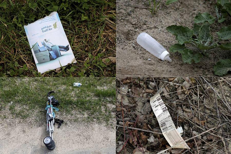 匆忙之中留下的東西:行李標籤、奶嘴瓶、手套、行李箱脫掉的輪子、推車、香煙盒和午餐。(路透社)