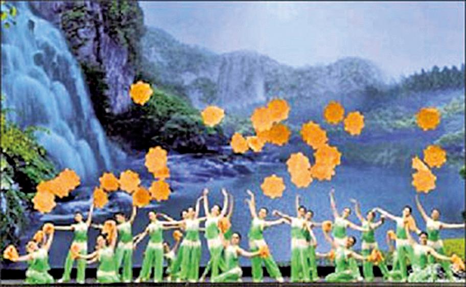 神韻晚會舞蹈節目《迎春花開》金黃色的四方布帕,在指尖平穩飛轉,旋出朵朵綻放的迎春花。(神韻網站)