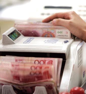 國際評級機構穆迪近日下調了中國信用評級,在國際社會引發震動,中國債務問題再引關注。(法新社)
