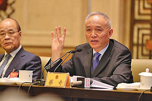 5月27日,北京市市長蔡奇(圖右)接替郭金龍任市委書記。(大紀元資料室)