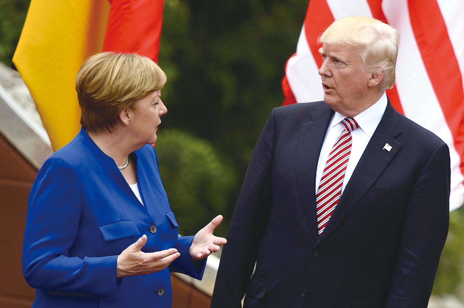 特朗普(右)和默克爾(左)在G7峰會期間。(AFP)
