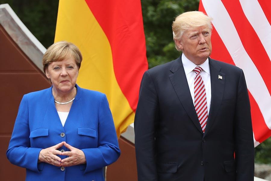 圖為德國總理默克爾和美國總統特朗普於5月26日在意大利舉辦的G7峰會上。(Sean Gallup/Getty Images)