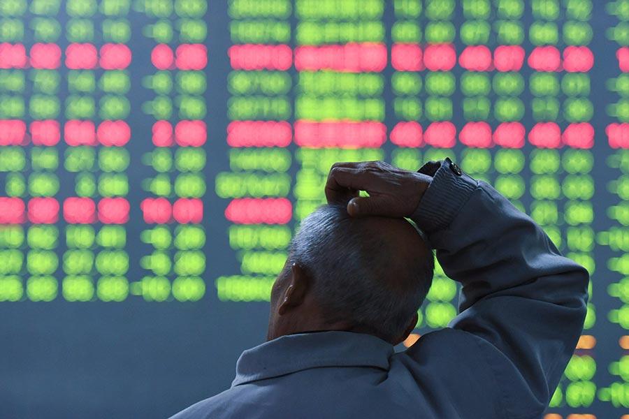 近來大陸A股表現低迷,多隻個股持續下跌,甚至閃跌,大陸股市股權質押風險激增。(AFP)