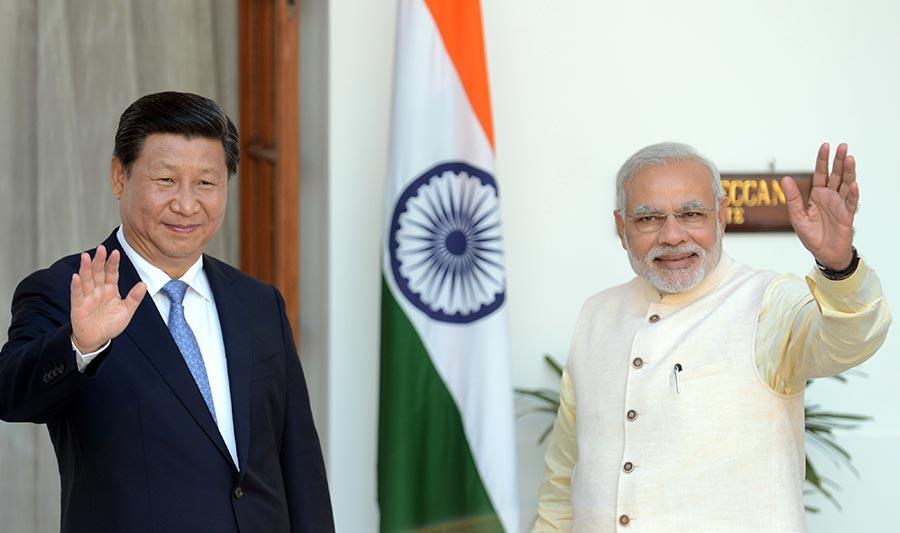 習近平對上一次訪問印度為2014年9月。圖為當時習近平抵達印度首都新德理,與印度總理莫迪會晤。(RAVEENDRAN/AFP/Getty Images)