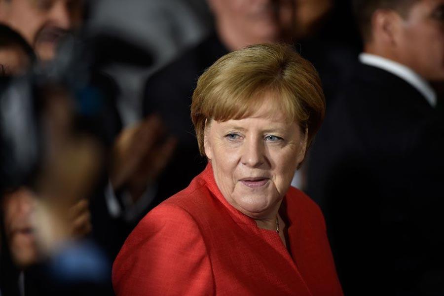 德國總理默克爾的民調最近攀升,恢復難民潮以前的水平。此圖攝於6月10日她在墨西哥訪問。(PEDRO PARDO/Getty Images)