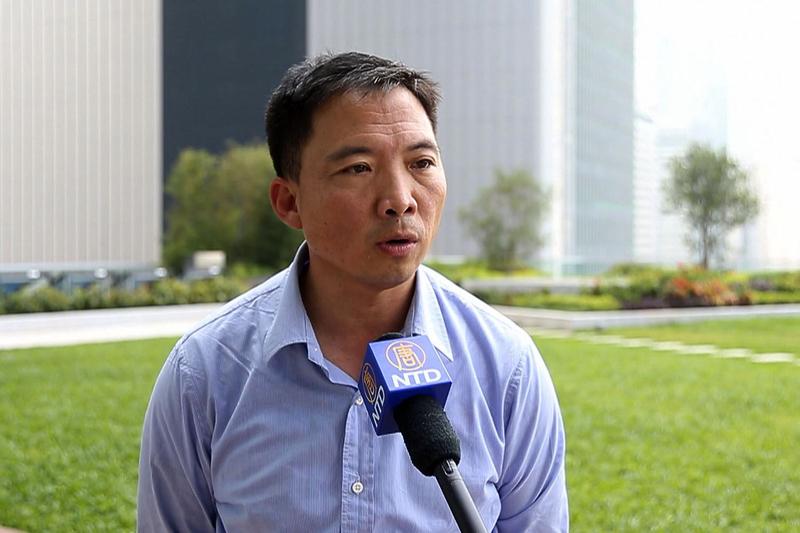 6月11日,民主黨在香港城市大學舉辦了「回歸20周年研討會」,並發表題為「回歸二十年一國兩制『不走樣、不變形』?」的報告。圖為民主黨主席胡志偉。(潘在殊/大紀元)