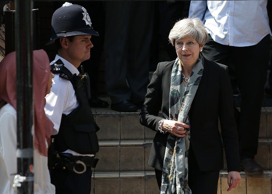 英國首相文翠珊發表聲明說,「仇恨與邪惡」將永遠不會成功。(DANIEL LEAL-OLIVAS/AFP/Getty Images)