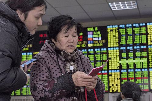 有分析認為,假如國民儲蓄可以進入股市,將是中共圈錢的新節奏,中國股民或遭遇更深度的收割。(AFP)