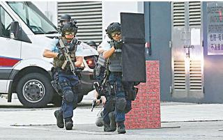 習近平訪港期間,消息指警方會出動約八千警力,保安達反恐級別。圖為警方5月舉行反恐演習。(警務處圖片)