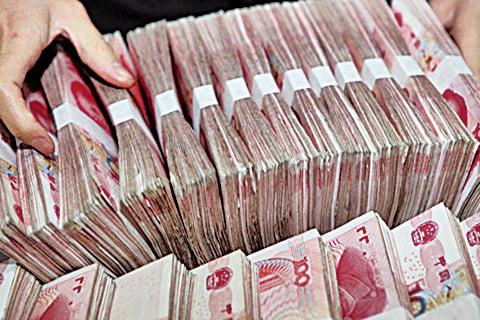 中國經濟學者盛松成16日分析表示,此次金融工作會議釋放出兩個信號。(AFP)