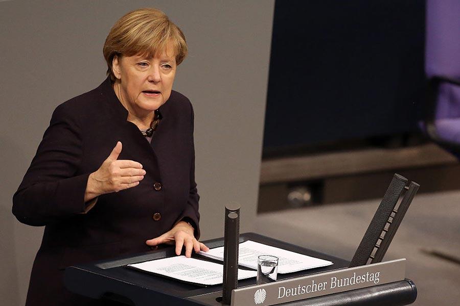 圖為德國總理默克爾。(Adam Berry/Freier Fotograf)