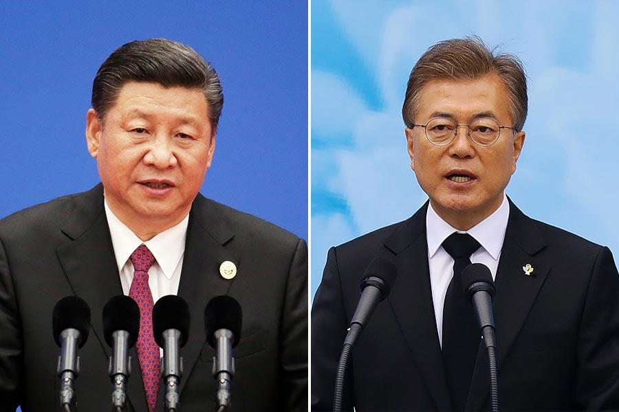 星期四(7月6日),南韓新任總統文在寅與中國領導人習近平在德國G20會議期間,進行了首次會晤。(Jason Lee-Pool, Chung Sung-Jun/Getty Images)