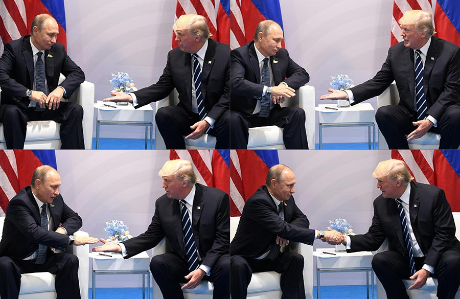 7月7日,美國總統特朗普與俄羅斯總統普京在G20會議上首次見面,特朗普主動伸手,還拍了普京手臂,兩人氣氛融洽。(SAUL LOEB/AFP/Getty Images)
