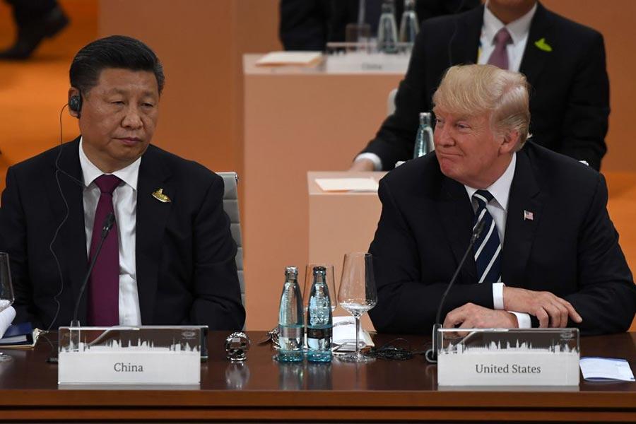 習近平與美國總統特朗普在G20峰會最後一天,舉行雙邊會晤,共同探討了一些「最尖銳的問題」,其中包括北韓問題。特朗普對習近平聲明,必須解決北韓問題,不管用甚麼手段。(PATRIK STOLLARZ/AFP/Getty Images)