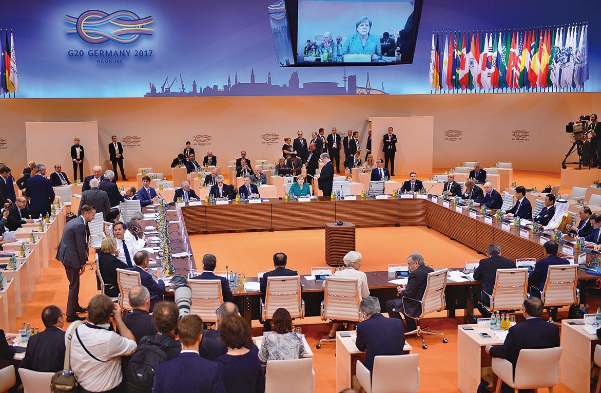 G20峰會中各國官員挑燈夜戰商討聯合公報,終於克服歧見完成大部份內容,僅氣候變化議題尚待討論。(Getty Images)