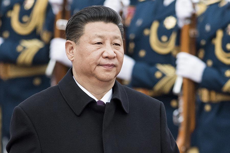過去中共經濟命脈被江派人馬把持,目前習近平當局把防金融風險提到國安安全的高度。(FRED DUFOUR/AFP/Getty Images)