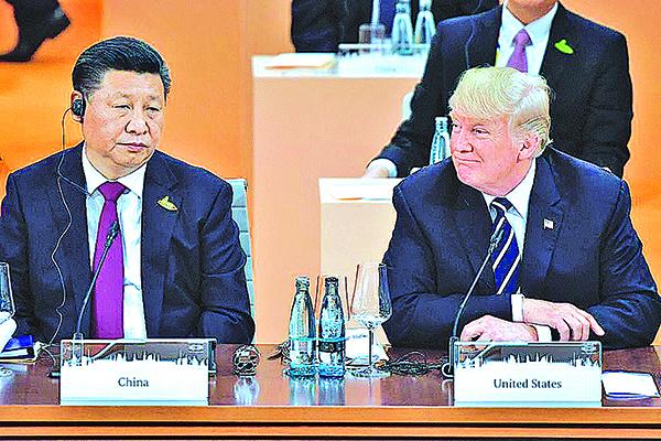 習近平與美國總統特朗普在2017年G20 峰會最後一天,舉行雙邊會晤,同意在貿易和北韓問題上繼續合作。(Getty Images)