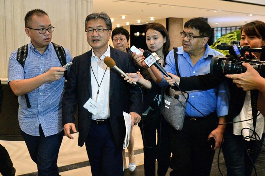 尹汝尚對東南亞訪問的第一站是「東北亞合作對話」(NEACD)會議。(ROSLAN RAHMAN/AFP/Getty Images)