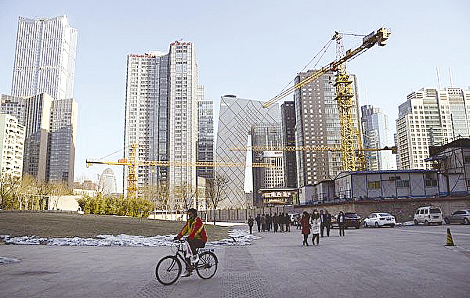 今年以來,龍頭房企之間的併購開始加劇。(WANG ZHAO/AFP)