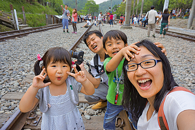 2014年阿恒一家四口到台灣旅遊。(受訪者提供)