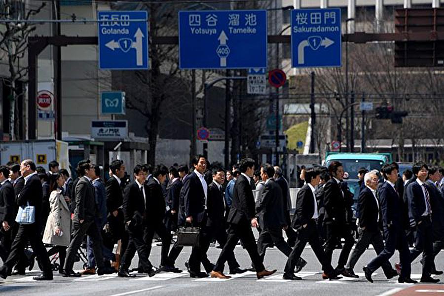 Mizuho綜合研究所日前就日本人口動態發表報告,指遷入日本國內的外國人的增加超出預料。(Getty Images)
