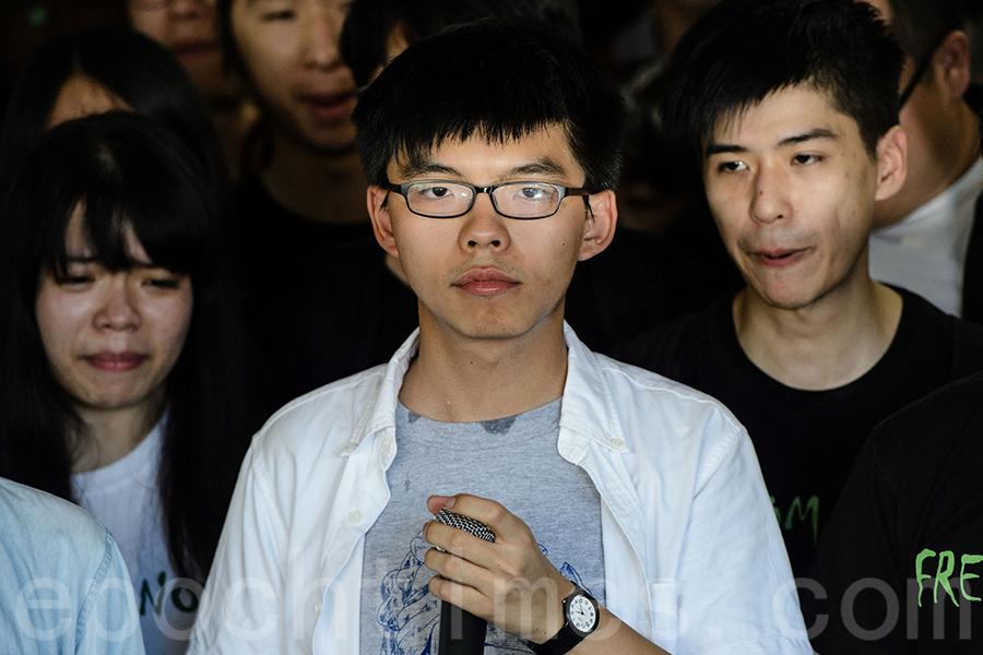 黃之鋒說,入獄前的心願是港人「撐住,不要放棄。」(Getty Images)