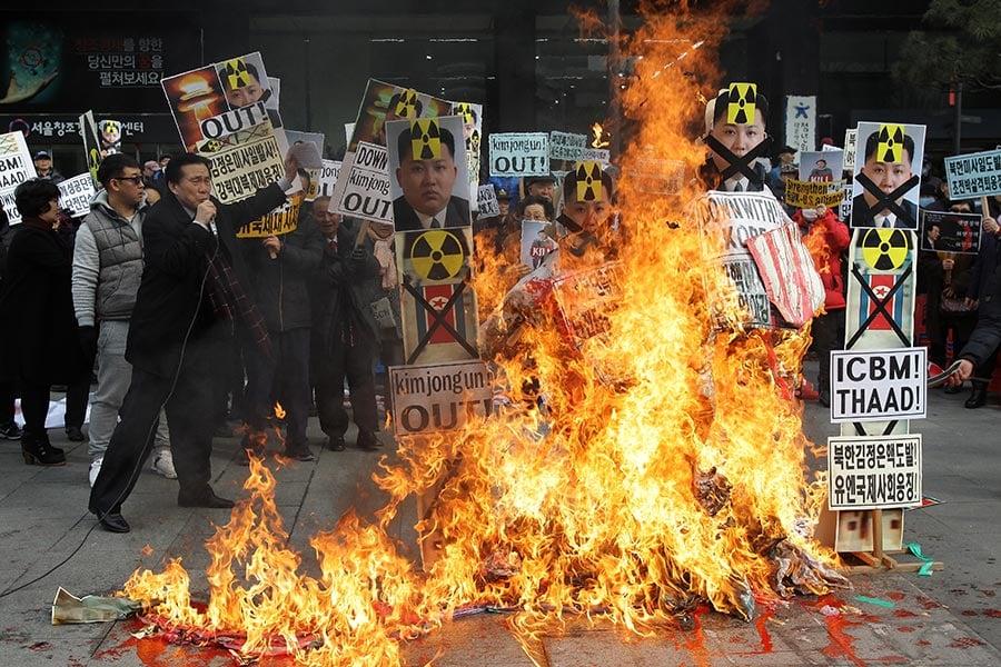 一名脫北者說,基督教在北韓日漸生根,更多人不把金正恩視為「神」,轉而尋求宗教信仰,平壤共產政權搖搖欲墜。(Chung Sung-Jun/Getty Images)