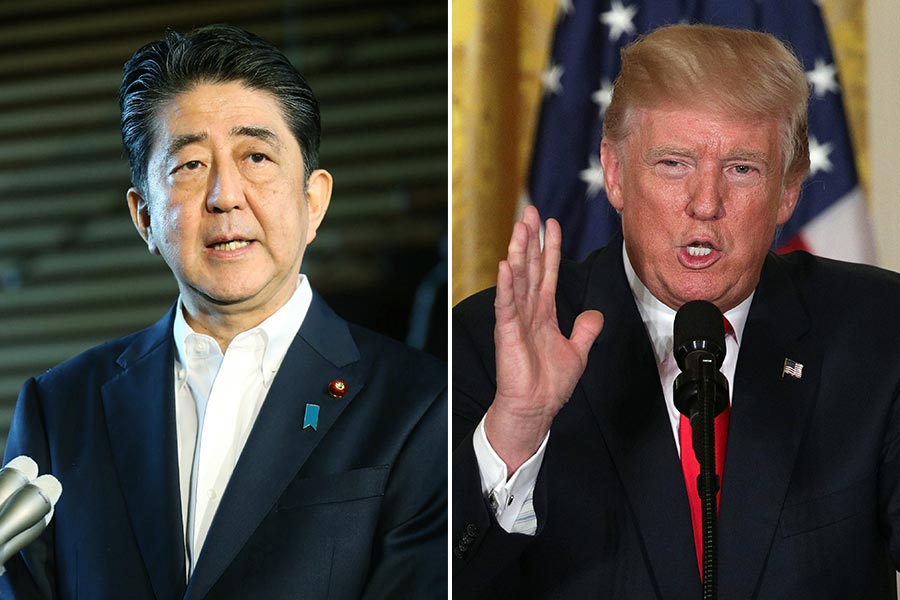 北韓導彈飛越日本上空,日本首相安倍晉三(左)於今日上午再度與美國總統特朗普(右)通電話,雙方均同意進一步加大對朝施壓。(STR/AFP, Alex Wong/Getty Images)
