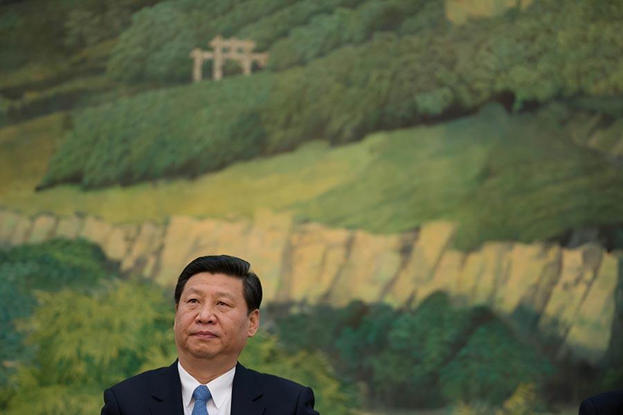 中共周日(2月25日)為習近平無限期掌權鋪平道路,提議取消國家主席最多任期兩屆的限制。 (AFP PHOTO / Pool / Ed Jones)