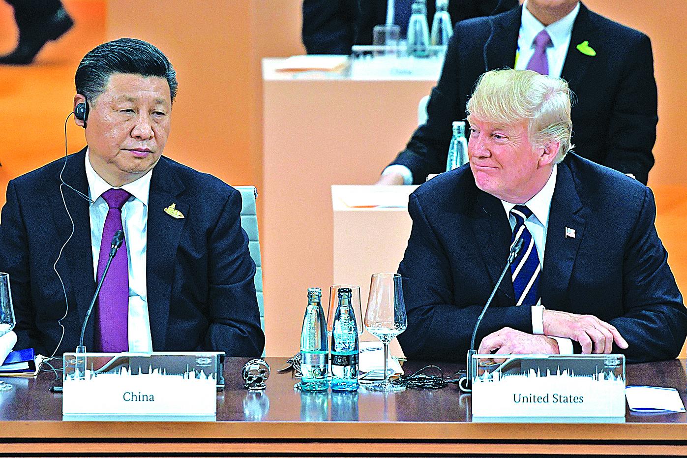 特朗普總統上周三跟習近平就北韓問題再次通話。特朗普表示雙方都非常坦率和堅定。圖為7月7日習近平和特朗普在德國漢堡G20峰會期間共同參加一個工作會議。(Getty Images)