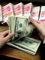 中共央行取消「兩金」人民幣升勢難續